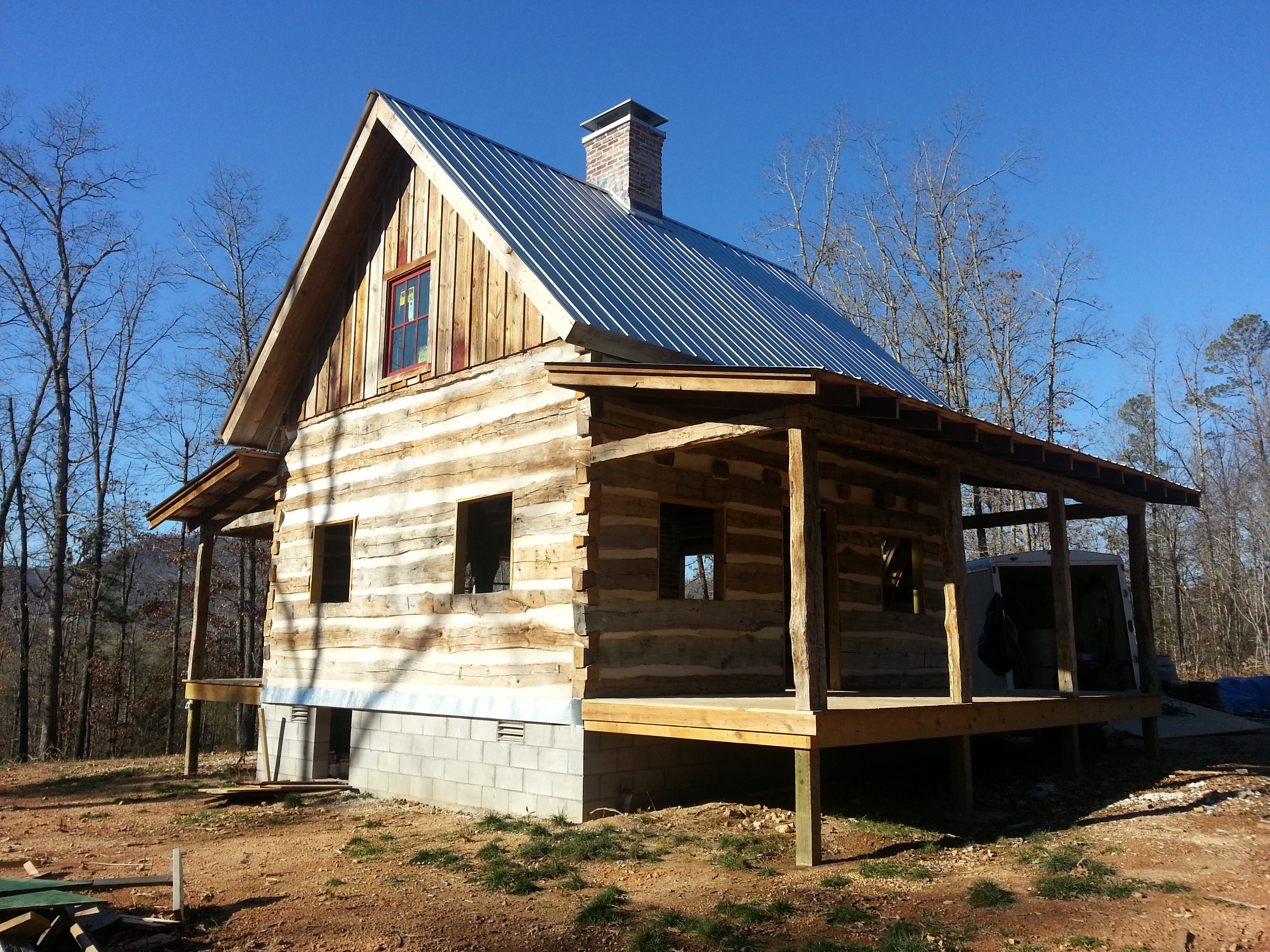 Antique log cabin project nearing completion ozark for Country cabin kits